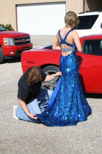 Mom helping out with the dress. I still love it. A lot.